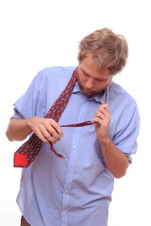 Man trying to bind a tie on his neck photo