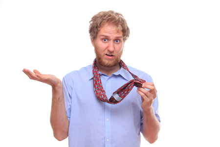 Man trying to tie a tie photo