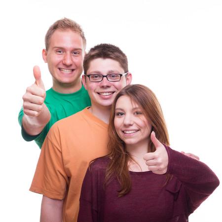 Three Friends giving OK - studio shot photo