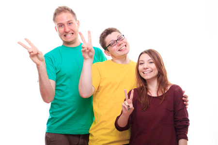 Three people showing victory sign - studio shoot