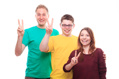 Three people showing victory sign - studio shoot photo