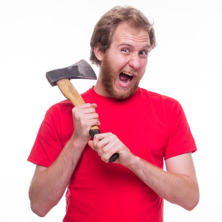 cut off head: Man tries to cut off his head with an ax - studio shoot Stock Photo