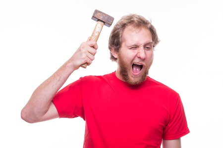 dissatisfaction: Man banging a hammer on the head - studio shoot