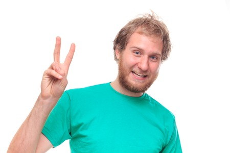 old sign: Bearded happy man showing victory sign - studio shoot Stock Photo