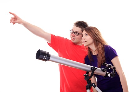 an eyepiece: Two people observe through a telescope - studio shoot