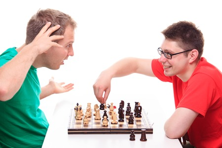 playing chess: Man loses while playing chess - studio shoot
