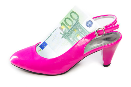 slut: high heel shoes and money Stock Photo