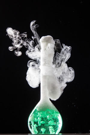 volumetric flask: Chemical reaction in volumetric flask glass in labolatory - studio shoot