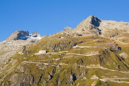 dangerously: High mountain Furka Pass in the Swiss Alps, Switzerland Stock Photo