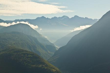 View of misty alpine valley, Switzerland photo