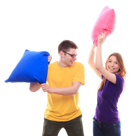 pillow fight: boy and girl pillow fight - studio shoot