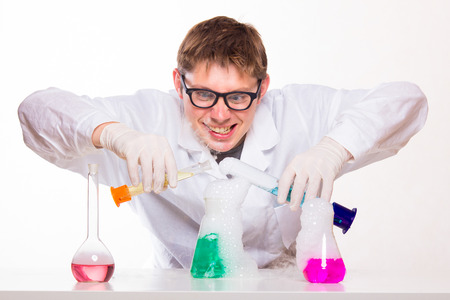 studio shoot: mad chemist in the lab doing reaction - studio shoot