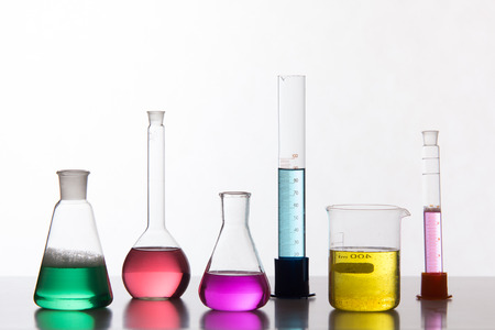 boiling tube: Glass in a chemical laboratory filled with colored liquid during the reaction - studio shoot