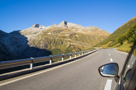 dangerously: View from the window of the car on the Furka Pass in Switzerland