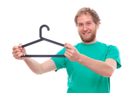 funy: Bearded cheerful man holding clothes hanger - studio shoot Stock Photo