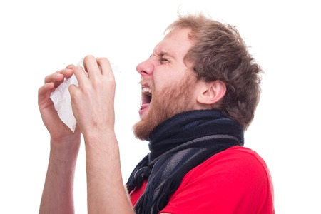 Sick man sneeze into handkerchief - studio shoot