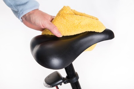 studio shoot: Bicycle saddle cleaning of dust with a wet cloth - studio shoot