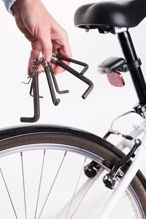allen key: Adjustment and repair of the bike with the allen key - studio shoot Stock Photo