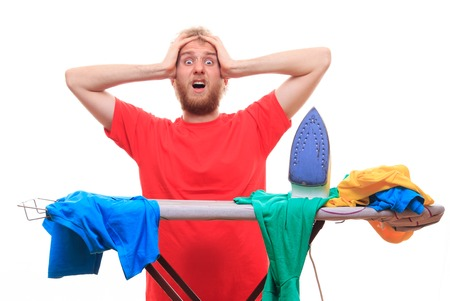 without clothes: Man has a problem with ironing on board - studio shoot Stock Photo