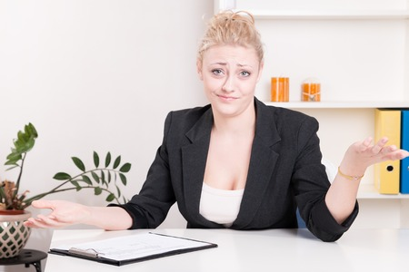 Dissatisfied employer woman during interview at office - studio shoot