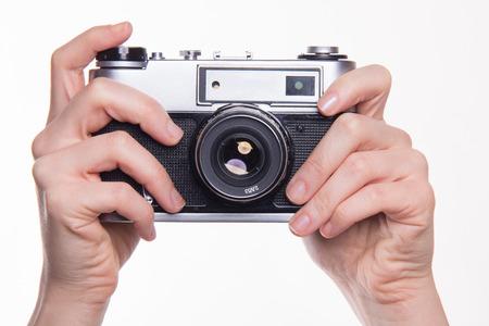 analog camera: Classic 35mm old analog camera on white - studio shoot Stock Photo