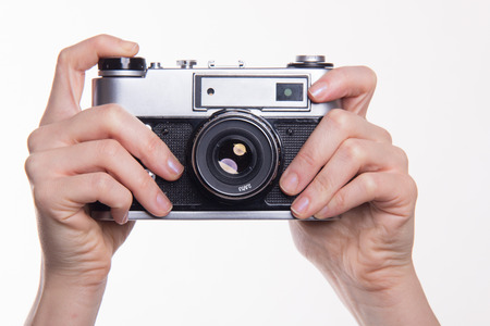 35mm: Classic 35mm old analog camera on white - studio shoot Stock Photo