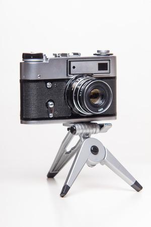 analog camera: Classic 35mm old analog camera on tripod - studio shoot Stock Photo