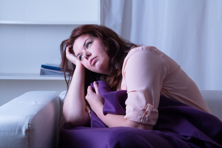 power nap: Woman suffering from insomnia - studio shoot Stock Photo