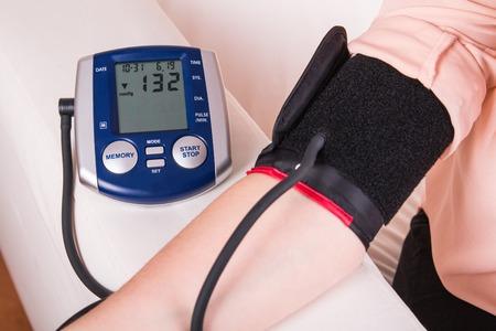 blood pressure gauge: Blood pressure gauge examination - doctors office Stock Photo