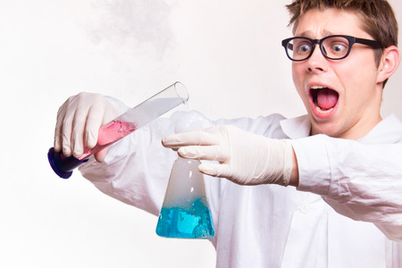 dangerous man: Dangerous accident in a chemistry lab during the reaction - studio shoot Stock Photo