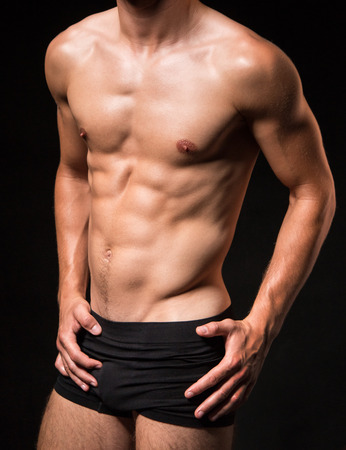 boxer shorts: Muscled sexi torso of a man - studio shoot Stock Photo