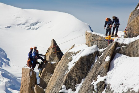 Alpine climbers climbing on a rock in the Mont Blanc massif in France, 20.09.2012 Stockfoto