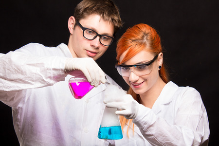 studio shoot: Two chemists holding a test tube in a lab - studio shoot