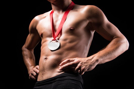 nacked: Medal on the chest - studio shoot