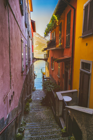 Narrow street going down to the Lake Como in Italy