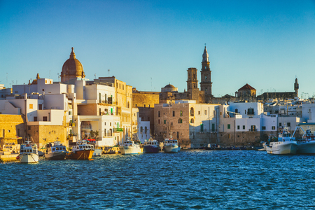 View of scenic city scape and a fishing harbor with marina in Monopoli, Italy 版權商用圖片