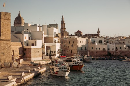 View of scenic city scape and a fishing harbor with marina in Monopoli,