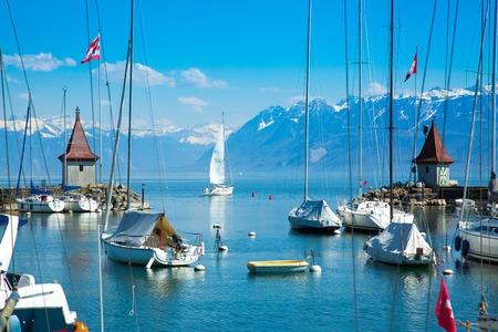 Picturesque little port and sailing boats on Lake Geneva in Morges Фото со стока