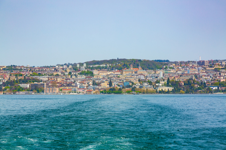 Panorama of Lausanne city taken from boat on Geneva Lake