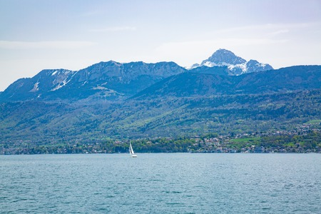 Lake Geneva and Evian-les-Bains city in the background in France