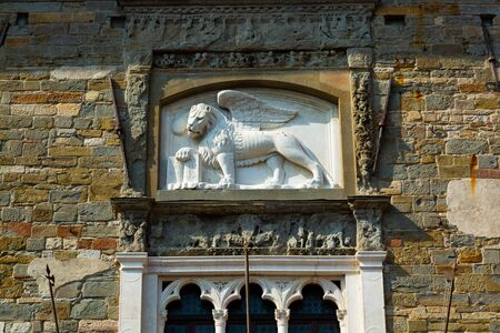 Lion Chimera bas-relief on the old twon building in Bergamo, Italy Reklamní fotografie