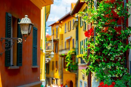Colorful narrow old town street in Bellagio Town, Italy