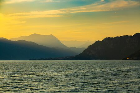 Idyllic sunset over Lake Como next to Lecco city, Lombardy, Italy