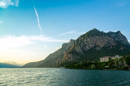 Lake Como surrounded by mountains over Lecco city, Lombardy, Italy Reklamní fotografie