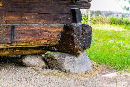 Fragment of old wooden farm house build on stone Reklamní fotografie