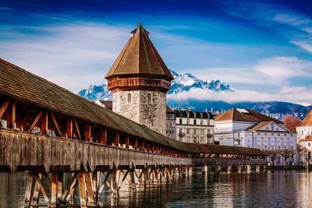 Kapellbrucke historic Chapel Bridge made by wood and waterfront landmarks in Lucern Stockfoto - 130067213