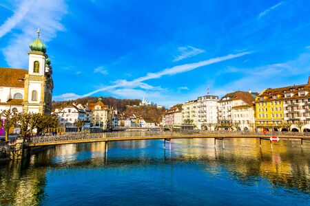Old town buildings and bridge over River Reuss in Lucerne city, Switzerland