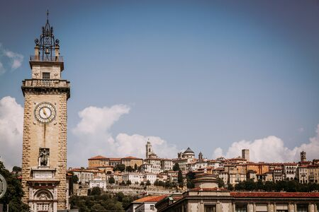 Citta Alta view and clock tower in Bergamo city, Italy Stockfoto - 130067434