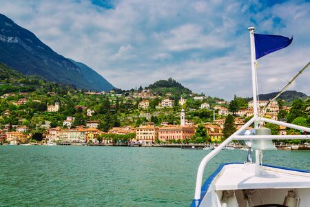 Menaggio town seen from ferry on the Lake Como, Lombardy region in Italy