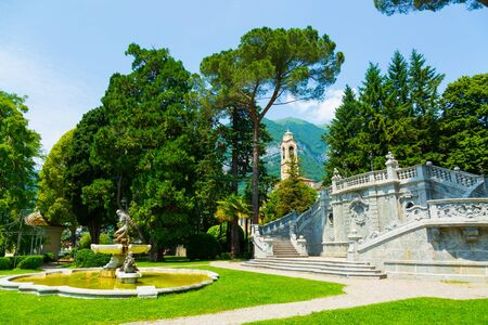 Ornamental fountain in city park over the Lake Como in Tremezzo town in Italy
